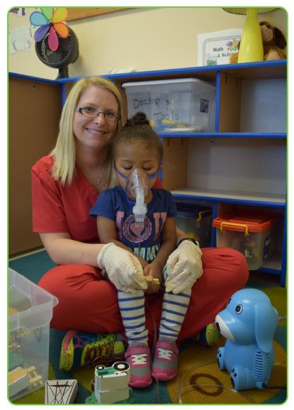 Nurse treating asthma patient